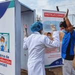 Municipalidad de Lima implementa la primera cabina de desinfección portátil en el Mercado Mayorista Móvil